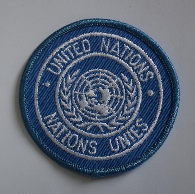"Тканини. ""Шеврон-нашивка ООН ""UNITED NATIONS""."