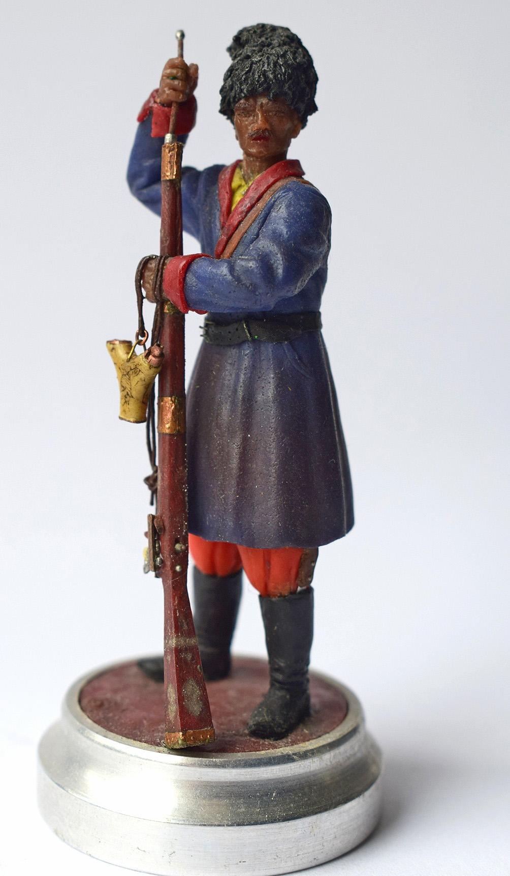 """Історична мініатюра. """"Запорізький козак, що заряджає яничарку. XVIІ-XVIII ст."""""""