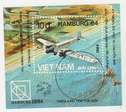 "Марка-блок поштова гашена. ""Triển Lam Tem The Gioi. Hamburg 1984.Kỷ niệm Lan thu 50 chuyen bay Dau tien Qua nam Dai Tay Duong. Việt nam"""
